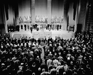 Edward R. Stettinius, Jr., U.S. Secretary of State and chairman of the U.S. delegation, addresses the 16th Plenary Session on June 26, 1945. President Harry S. Truman is to his left.