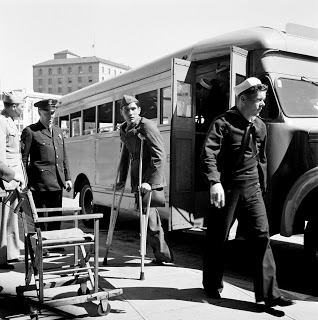 Wounded veterans arrive at the Opera House for the Second Plenary Session on April 27, 1945.