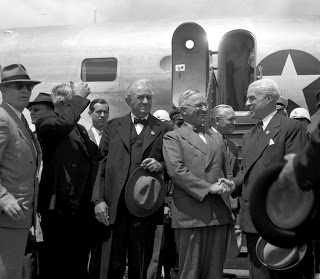 President Harry S. Truman is greeted at the San Francisco airport by Edward R. Stettinius, Jr. (right) and Senator Tom Connally (left), members of the United States delegation.