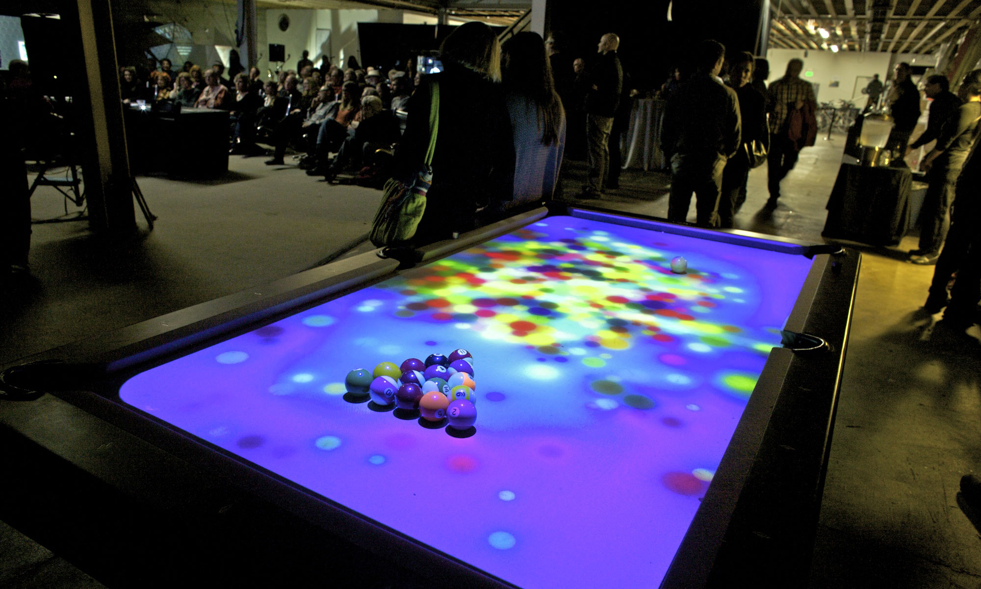 Light projection on a billiards table at Obscura Digital