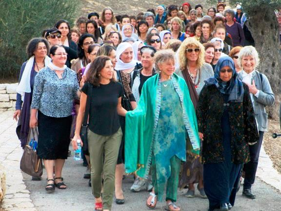 Anna Halprin Leading a Women's Peace Walk on the Rhoda Goldman Promenade, Israel, 2014 Courtesy of Sue Heinemann Anna Halprin (front row, center) leads a peace procession on the Rhoda Goldman Promenade designed by her late husband, the renowned landscape architect Lawrence Halprin. Next to her (our left) is Susie Gelman, daughter of Richard Goldman, who commissioned the promenade.